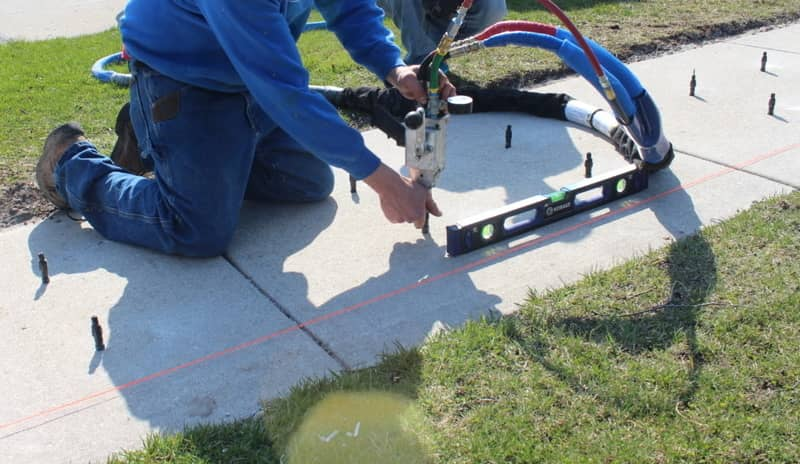 A concrete sidewalk of a home in Greenwood, Lincoln getting measured and prepared for concrete raising.
